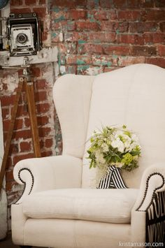 Heavenly Blooms: Black and White Urban Loft Wedding Wedding Lounge, Loft Wedding, Upholstered Chairs, Ikea Chairs, Wingback Chairs, Garden Table And Chairs, Urban Loft, Table Arrangements, Chairs For Sale