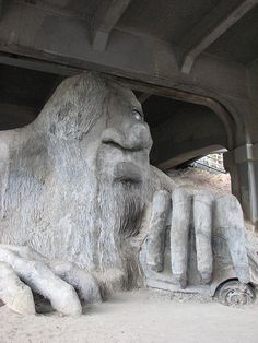 The Fremont Troll lurking under the north end of the Aurora bridge -- in the Fremont neighborhood of Seattle, Washington. Yes, that's a full-size VW Bug he's holding onto, there.