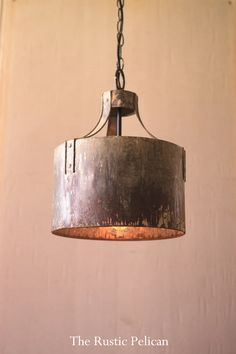 Kalalou Metal Cylinder Pendant Light - Rustic metal riveted arms clamp to a cylindrical pendant creating industrial light and more than a little magic. Pair two or more over a workspace or kitchen island. Rustic Chandelier, Cylinder Pendant Light, Pendant Light Fixtures, Rustic Pendant, Rustic Pendant Lighting, Drum Pendant Chandelier, Rustic Light Fixtures, Rustic Metal, Industrial Lighting