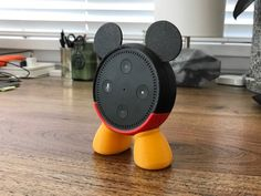 An Echo Dot holder so even Alexa can have a set of mouse ears. 40 Disney Products You're Never Too Old To Love Mickey Mouse Outfit, Mickey Mouse Head, Mouse Ears, Amazon Dot, Amazon Echo, Disney Rooms, Disney Nursery, Estilo Disney