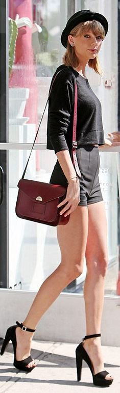 Taylor Swift's red handbag, black sweater, hat, and platform sandals style id