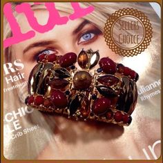 Stunning Crystal Bracelet-Host Pick This stunning bracelet has color tones of rust, red, black. Set on a gold tone setting. Measures 9 inches and is a stretch design. Pictures do not do it justice. (This closet does it trade or use PayPal) Jewelry Bracelets