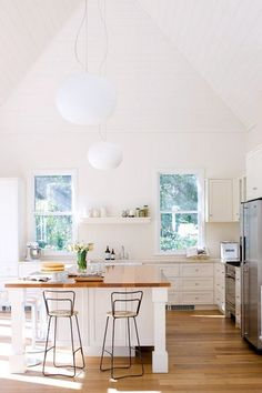 White Kitchen + Wood Bench + High Ceilings + Natural Light