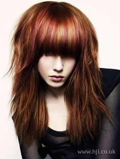 Red long fringe hairstyle, long hair was cut into graduated layers with a chunky eyelash skimming fringe...Hair was blow-dryed to creat texture and movement, while the fringe was finished with straightening irons for contrast.