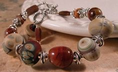 Handmade bracelet, organic reds lampwork, agate and sterling silver | cserpentDesigns.com