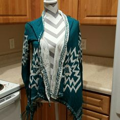 ♡SALE♡ Aztec patterned long sleeve Great layering piece! Cute Aztec pattern with tassels on the bottom. Fits true to size! Sequin Hearts Tops