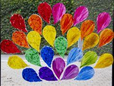 Iedere kleuter uit de klas kleurt één toverdruppel, samen wordt zo een mooie regenboog gemaakt.