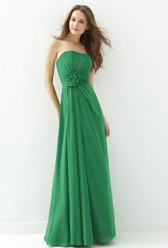 Brides.com: Kelly Green Bridesmaid Dresses. Kelly Green Bridesmaid Dress: B2. Style B134006, strapless neckline dress with ruffled chiffon flowers and natural waist, includes detachable spaghetti straps, and is also available in knee-length and floor-length, $265, B2  See more B2 bridesmaid dresses.