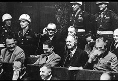Former Third Reich leaders laugh at a translation error during the Nuremberg Trials (1945-1946).