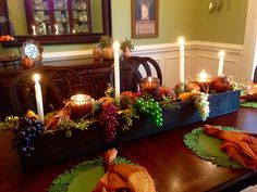 Fall table scape, thanksgiving, fall, candles, grapes, pumpkins