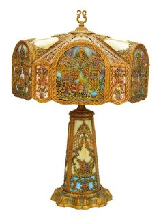 AN ANTIQUE AMERICAN ART NOUVEAU RAINBOW SLAG GLASS CAROUSEL FAIRY THEMED LAMP Chicago, United States, Early 20th Century