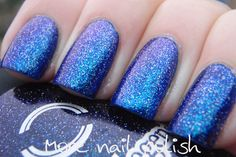 Dance Legend Tops for Dark 607 over navy polish. The blue glass flecks shift to a bright purple, which I totally failed to capture and the silver dots all over the nail are silver holo glitters. The colour shift in this is so much more predominant than the photos show.