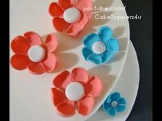 A beautiful, simple, and easy to make fondant/gumpaste flower. For cake or cup cake toppers.