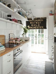Google Image Result for http://www.narratives.co.uk/ImageThumbs/BP008_20/3/BP008_20_White_galley_kitchen_with_vintage_kitchenware_and_black_roller_blind_in_Winchester_home__Hampshire__.jpg