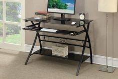 This spaciously designed black writing desk features a wide tabletop, keyboard tray, and lower shelf perfect for your home office provide functionality and style. Black Glass Computer Desk, Black Glass Desk, Big Desk, Wall Mounted Desk, Desks For Small Spaces, Low Shelves, Shelf, Glass Shelves, Simple Desk