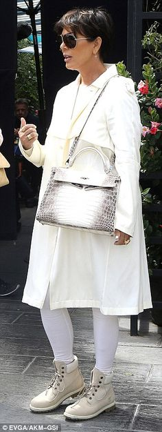 Keeping it with Kris! Jenner wore a cream and white ensemble made up of a duster coat and ...