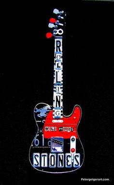 A license plate guitar for the Rolling Stones had to be a telecaster because it's Keith Richards' favorite style. I chose black, red and white because it's the colors of the Stones' famous tongue logo.