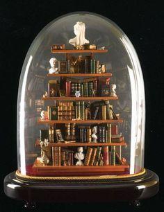 Dollhouse library beneath a glass cloche by Ettore Sobrero