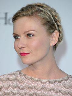 While it might not be the easiest style to copy, Kirsten's pretty plaited updo is just as suited to brides-to-be as it is a festival field. Adding a thin gold headband and wearing her halo braid nearer the back of her head towards her crown gives her 'do a regal feel and doesn't detract from her hot pink lips and beautifully shaped brows  -Cosmopolitan.co.uk