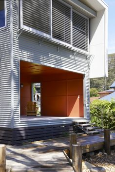 outdoor room lined in HardieFlex & batten cladding - painted - & operable sliding louvre shutters at the Yattalunga House NSW, Dianna Thomas Architect