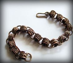 Men's bracelet made from copper tubing from the hardware store. I flared each end and wrapped it with hand twisted wire.