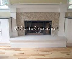 tile for fireplace: tan pebble tile fireplace