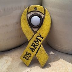 A yellow ribbon is used as a symbol of support for our troops who fight for our freedom.