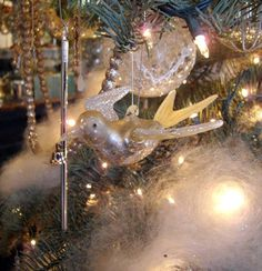 Oh, Christmas Tree.....  Decorate your tree with wonderful faux snow made of mohair with sparkly mica, vintage mercury icicles and glass birds. We used two packages of snow on our tree. Not only does one package go a long way but the 'snow' is reusable for years to come.