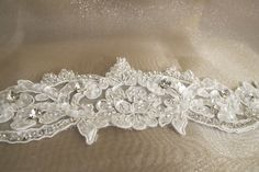 Beaded Bridal Belts Wedding Sash Belt with Rhinestones and Crystal Beads off white. $35.00, via Etsy.