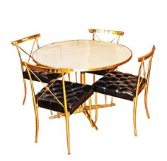 Brass table + black patent leather tufted chairs by Billy Haines Regency Furniture, Furniture Decor, Modern Furniture, Furniture Design, Dining Table Chairs, Dining Set, Dining Rooms, Tufted Chair, Modern Chairs