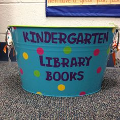 A metal tub with vinyl letters for collecting those library books!   The handles make it easy for little helpers to carry.