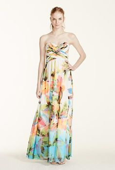 A strapless printed bridesmaid dress with a rhinestone bodice from @davidsbridal | Brides.com
