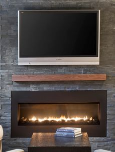 Room With A Fire Place And Two Indent Walls
