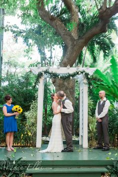 Sunflower theme wedding by Love In Bloom Florist at the Hemingway House Key West. Photo Megan Ellis Photography