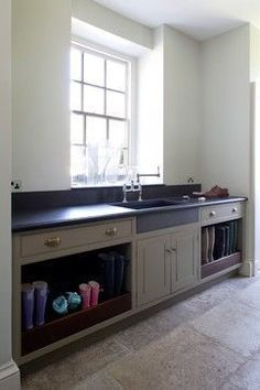 Boot Storage idea for under a counter in laundry room - Stackables next to it