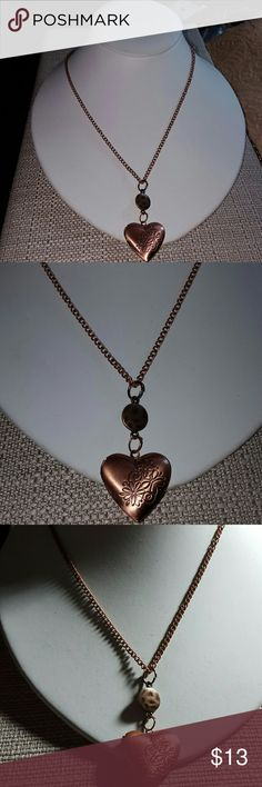 Antique Cooper Heart shaped Locket Antique Cooper Heart shaped Locket.   20 inches antique cooper chain in length.  Great to put your favorite tiny picture inside. Jewelry Necklaces