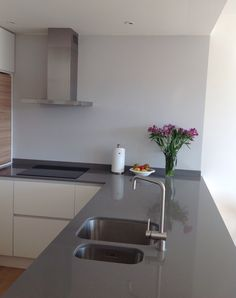 Bespoke kitchen by http://www.rb-t.cz/, semi mat lacquered white handles doors, worktop by Technistone.