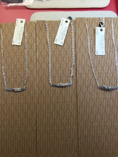Wire wrapped bar necklace. Available with gold or silver chain in 16 inch or 18 inch. With and without rhinestone.