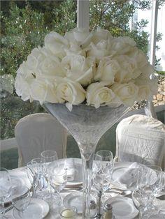 white roses in martini glass