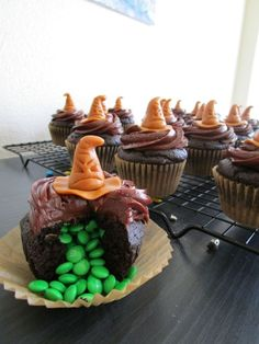 Check out the Harry Potter Sorting Hat cupcakes I made! You get sorted into a Hogwarts house depending on the color of the M&Ms that spill out. Apparently I'm a Slytherin... by Nora Lina Vazquez