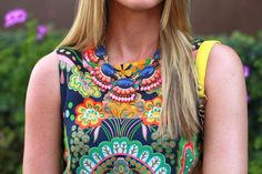 Nanette Lepore top and J. Crew necklace.