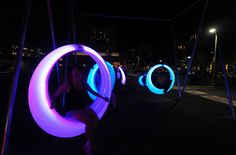 """A new art installation that features 20 glowing """"swings"""" suspended by wire is opened at Lawn on D on September 11!"""