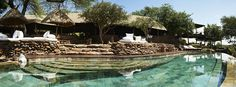 Built on a gently sloping hill, this riverine lodge, positioned on the renowned migratory route, Singita Faru Faru is a place where you can quite literally expect the unexpected. Beautiful Places To Visit, Places To See, Safari Adventure, Africa Travel, Best Hotels, Around The Worlds, Tanzania Africa, Holiday Resort, Game Reserve