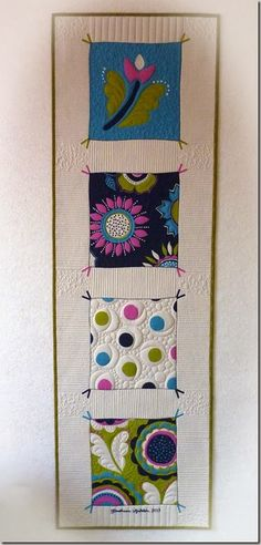 Table runner turned wall-hanging - love the colors