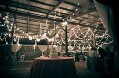 Hanging Lanterns and Globe String Lights is a delightful way of brightening up a dark wedding reception space.