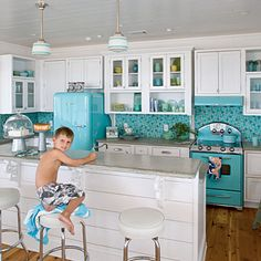 Oooh groovy, retro blue! The turquoise tiles, refrigerator, and stove work flawlessly together here. They're a little more of an investment than paint, though! Source