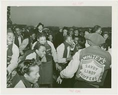 Jacket worn by Whitey's Lindy Hoppers dance troupe. Jacket was green & yellow.