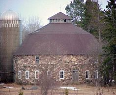 Round Barn  Southeast of Hurley. US51 south 2.6 miles from jct with WI77 in Hurley, east on Rein Rd. 0.8 miles, north on DuPont Rd. 0.4 miles to the barn on the E. side of the road up a driveway 0.15 miles. Abandoned and driveway blocked. Iron Co - WI