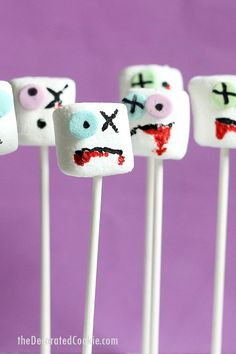 The original Zombie marshmallows on a stick for a spooky Halloween party food. All you need are food pens and sprinkles.