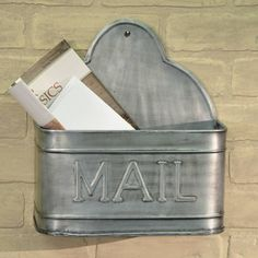 "Wall-mount tin mail holder has a lovely vintage look as well as being oh.so.functional! Now all the incoming mail has a place to be stored before sorting instead of cluttering the counters. The Tin Mail Holder measures 11""W x 12.75""H x 5.5""D."